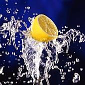 Half a lemon on splashing water