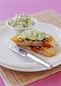 Toasted baguette slices with pea puree