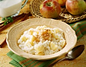 Apple rice pudding with cinnamon and sugar on plate