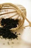 Dry green jasmine tea in bamboo tea strainer