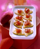 Parmesan biscuits with tomato and onion salsa