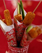 Fish finger kebabs with chili tomato sauce in paper bag
