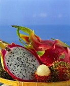 Red pitahaya, whole and halved, lychees
