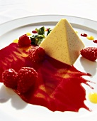 Panna cotta pyramid with raspberry sauce