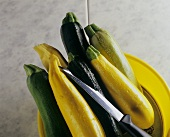 Various types of courgettes and a knife