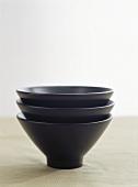 Three black food bowls
