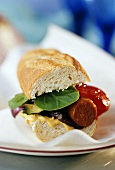 Paprika sausage and grilled vegetables in a sandwich