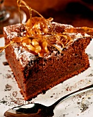 Piece of chocolate cake decorated with spun caramel & nuts