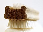 Nail brush on a piece of soap (close-up)