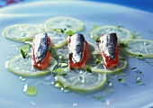 Marinated sardines on pieces of red pepper & lemon slices