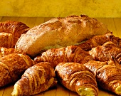 Fresh croissants and a loaf of bread