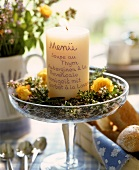 White candle as menu on lavender flowers in glass