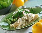 Fish fillet with mushroom and cream sauce and mangetouts