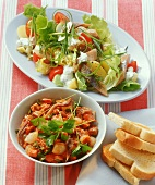 Herring salad and meat salad with tomato dressing