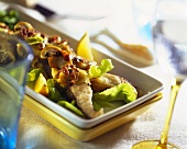 Fried carp with mushrooms, lemon wedges and salad
