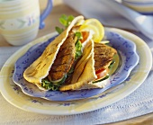 Fried liver and salad in pita bread