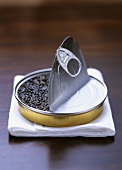 Russian sturgeon caviare in an opened tin on napkin