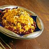Yellow rice with turmeric, pine nuts and pomegranate