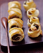 Puff pastry rolls with mushroom filling