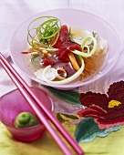 Tuna soup in glass bowl