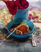 Plum soup with poppy seed dumplings in glass dish
