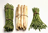 Three bunches of asparagus: green, white and wild asparagus
