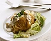 Oven-baked potato stuffed with mushrooms on salad
