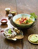 Fish curry in small bowl with Asian decoration