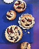 Several plum tarts
