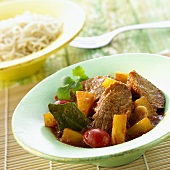 Duck curry with pieces of pineapple & cherry tomatoes (Thailand)