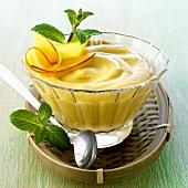 Asian mango cream in small glass bowl