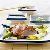 Four slices of duck Teriyaki on leeks (Japan)