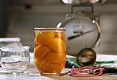 Bottled peach halves in jar