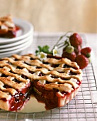 Strawberry tart with pastry lattice, a piece cut