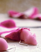 Pink marzipan mouse slipping out of a sock