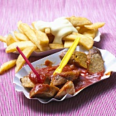 Vegetarian currywurst sausage with chips