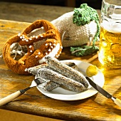 Knitted sausages, pretzel and radish with a litre of beer