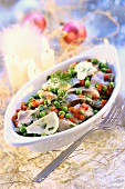 Herring salad with peas, diced peppers and spices
