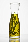 Rosemary oil in a carafe