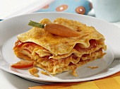 Carrot lasagne with tomatoes for children