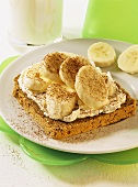Wholemeal bread with fresh cheese & banana slices for children