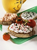 Three open sandwiches with different quark spreads
