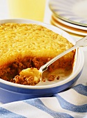 Baked mince and potato dish with cheese topping