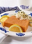 Fish pâté with rice and lemon slices