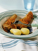 Breaded lamb cutlets with boiled potatoes