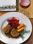 Venison cutlets in hazelnut crust with red cabbage