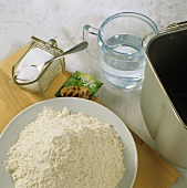 Ingredients for white bread dough (flour, yeast, salt & water)