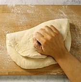 Pressing bread dough