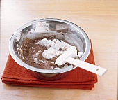 Making mocha soufflé: folding beaten egg white into cocoa mixture