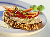 Rye bread with salmon spread and strips of pepper